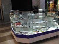 Торговые отделы островные из стекла, алюминия и ЛДСП